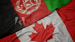 waving colorful flag of canada and national flag of afghanistan.